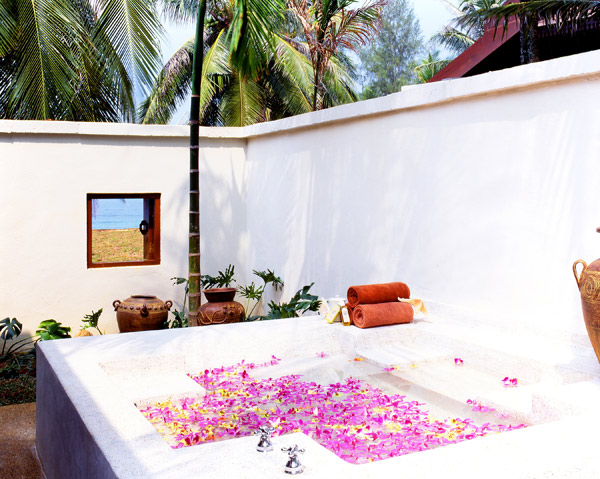 A spa bath strewn with flowers at Tanjong Jara Resort Malaysia